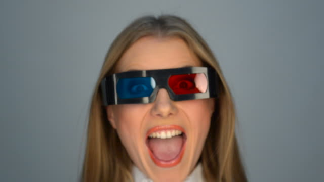 laughing and amazed woman in stereo glasses