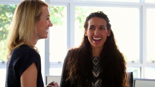MS Laughing businesswomen during informal meeting in office