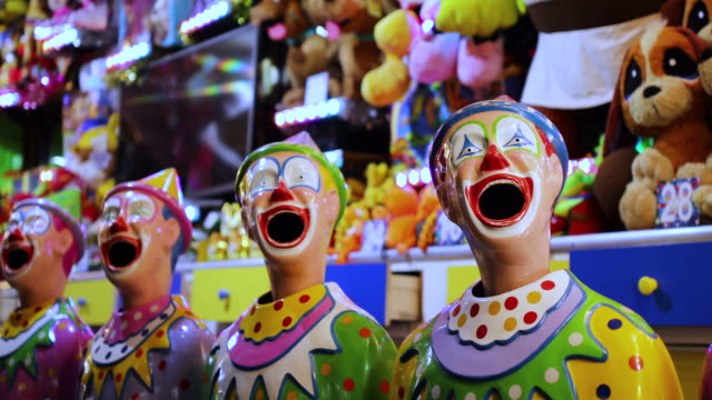 laughing clowns in sideshow alley at local fair - spooky stock videos & royalty-free footage