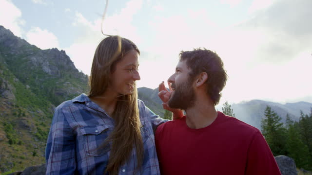 stockvideo's en b-roll-footage met ms laughing couple embracing at mountain lookout - mid volwassen koppel
