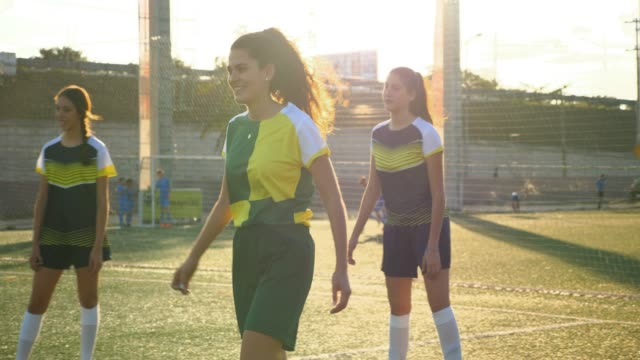 MS R/F Laughing female soccer player on field during game