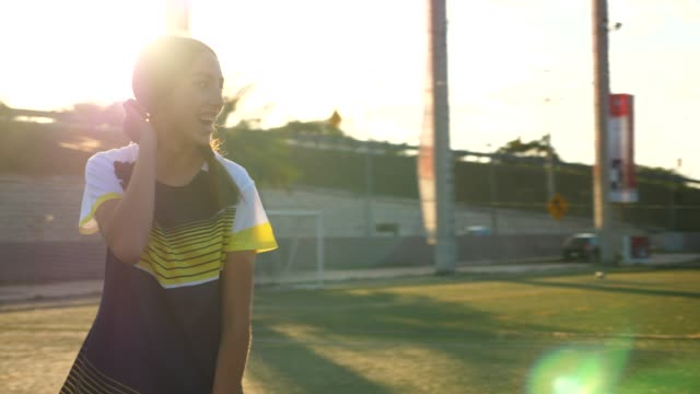 MS Laughing female soccer player on field during game