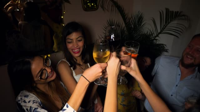 ms laughing friends toasting drinks in night club - wine stock videos & royalty-free footage