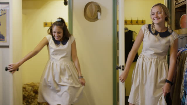 laughing girls trying on similar dresses in clothing store / provo, utah, united states - vergleich stock-videos und b-roll-filmmaterial
