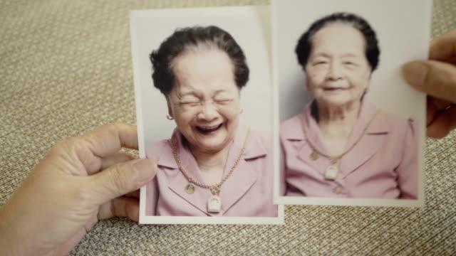 laughing : grandmother photo album - 80 89 years stock videos & royalty-free footage