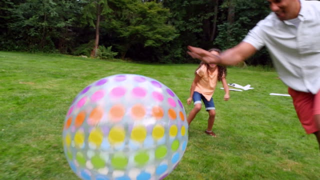 ms ts laughing kids playing with father in backyard - pacific islander family stock videos & royalty-free footage
