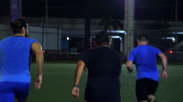 ms laughing male soccer players running sprints together while warming up before evening soccer match - warming up stock videos & royalty-free footage