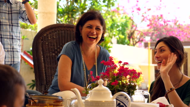 ms laughing mature woman in discussion with senior mother while hanging out during outdoor brunch - brunch stock videos & royalty-free footage