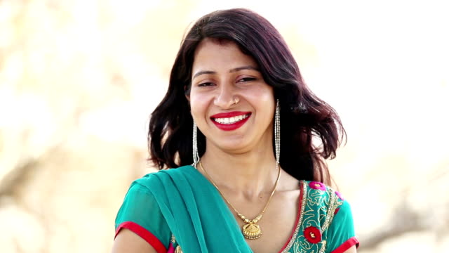 laughing portrait of a young woman - indian ethnicity stock videos & royalty-free footage
