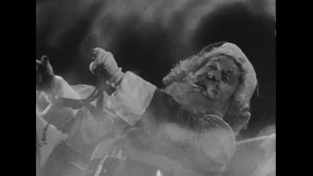 1946 a laughing santa names all his reindeer as he drives his sleigh - sledge stock videos & royalty-free footage