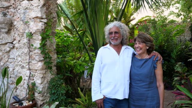 stockvideo's en b-roll-footage met ms laughing senior couple embracing in backyard garden during dinner party - rijk staat