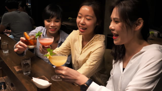 Laughing Taiwanese youth going out in nightclub and cheering