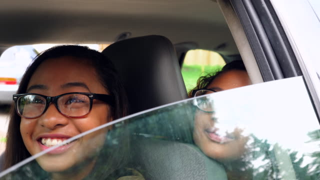 ms laughing teenage twin sisters learning to drive car - learning to drive stock videos & royalty-free footage