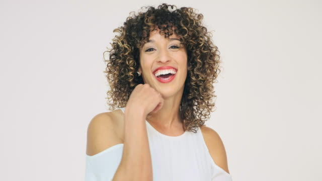 laughing woman high key in studio - high key stock videos & royalty-free footage