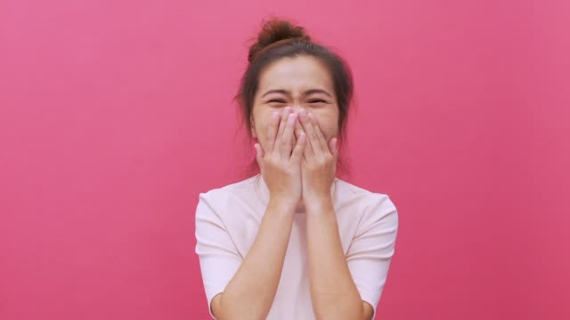 laughing woman isolated pink background slow motion - model object stock videos & royalty-free footage