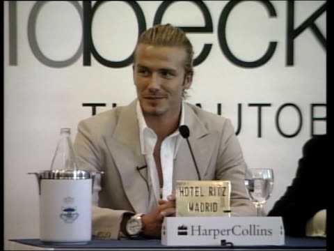 launch bullet-proof car; lib spain: madrid: int footballer, david beckham, at press conference to launch his autobiography - biografia video stock e b–roll