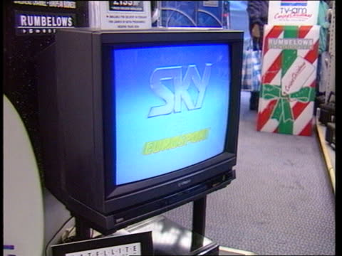 BSB launch delay London MS Rumbelows shop R INT ITN MS TV set showing 'Sky' ident PAN RL dish MS Price display card