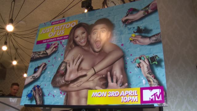 launch 'just tattoo of us' show: charlotte crosby and stephen bear interviews; stephen bear interview sot / close shot of tattoed hands / poster for... - tattoo stock videos & royalty-free footage