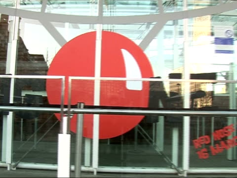 vídeos y material grabado en eventos de stock de launch of 2007 comic relief: celebrities launch red nose day at london eye; red nose logo painted on glass doors zoom in notice painted on door 'red... - red nose day