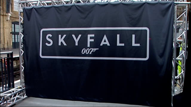 launch of new east coast train named skyfall england london kings cross station int skyfall curtain being put up on steel frame / people taking... - james bond fictional character stock videos and b-roll footage
