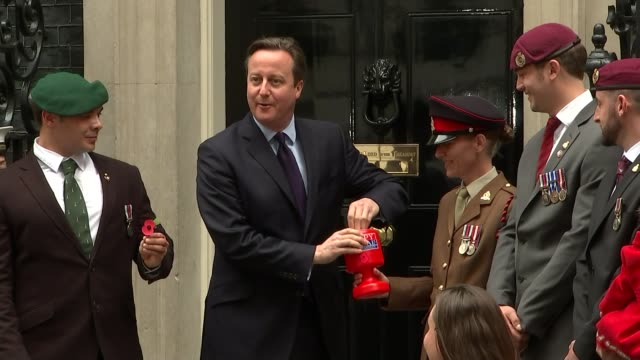 launch of poppy appeal 2015; england: london: downing street: ext people, including veterans, along downing street people along to number 10 david... - pinning stock videos & royalty-free footage
