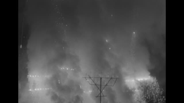 launchers shoot fireworks rockets into the air at winter olympics closing ceremony / fireworks explode in air with flags waving in foreground /... - olympic rings stock videos & royalty-free footage