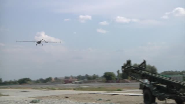 launching an unmanned aerial vehicle at forward operating base fenty afghanistan - 無人航空機点の映像素材/bロール