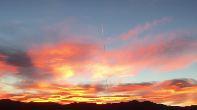 launching rocket at sunrise in death valley area - lenkflugkörper stock-videos und b-roll-filmmaterial