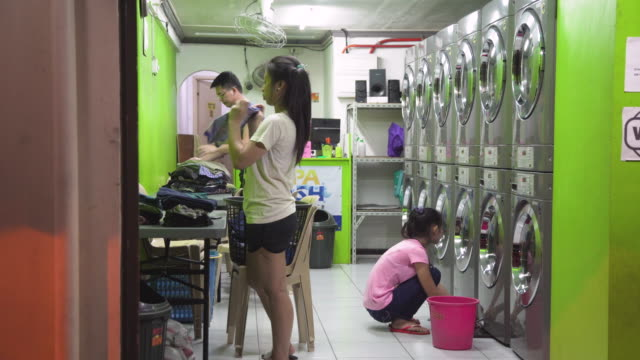 laundromat at manila, makati, philippines - waschsalon stock-videos und b-roll-filmmaterial