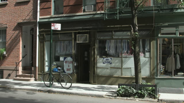 ms laundromat drycleaner storefront on quiet greenwich village side street - signage removed / new york, new york, usa - western script stock videos & royalty-free footage