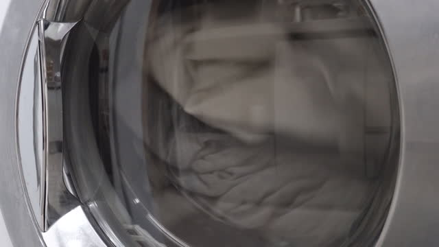 laundry - dryer drying laundry at home / seoul, south korea - tumble dryer stock videos & royalty-free footage