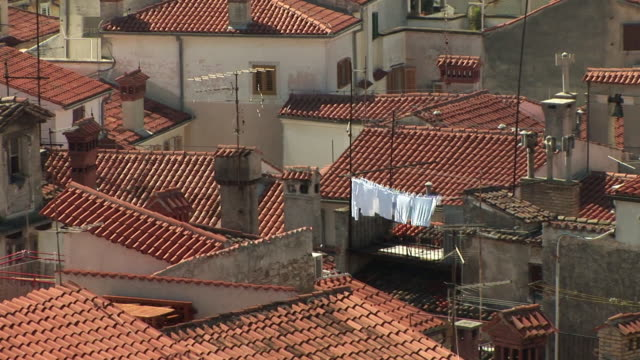 HA MS ZO WS Laundry drying on clothesline above rooftops of town with Adriatic Sea in background / Piran, Slovenia