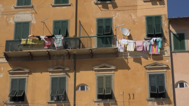 laundry drying on houses in portoferraio - washing line stock videos & royalty-free footage