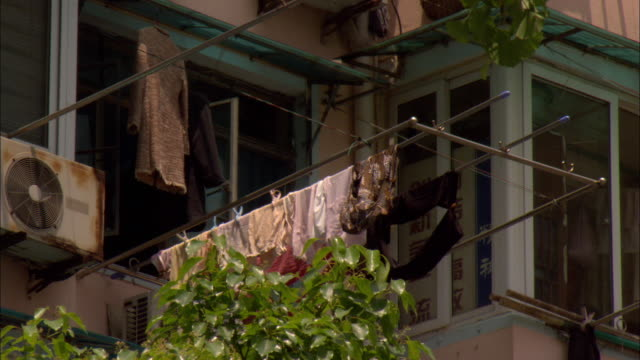 ms la laundry drying on rack outside apartment building, shanghai, china - drying rack stock videos and b-roll footage