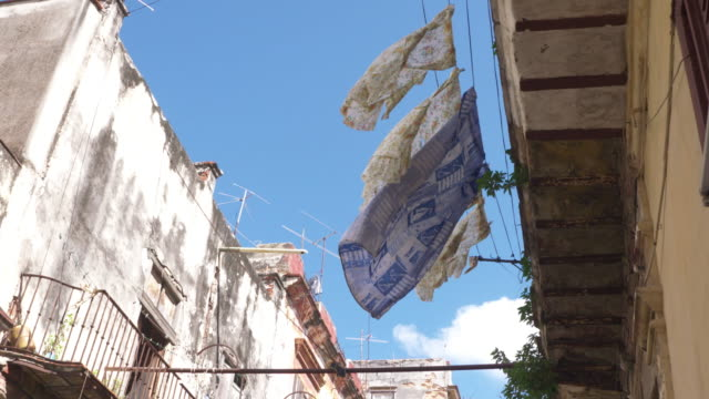 laundry hanging on clotheslines in balcony / havana, cuba - clothes peg stock videos & royalty-free footage