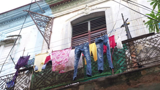 laundry hanging on clotheslines in balcony / havana, cuba - clothesline stock videos & royalty-free footage