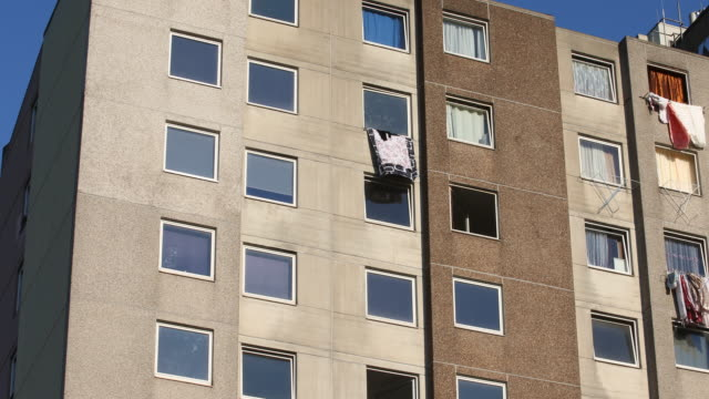 laundry hangs out of a window at a a high-rise apartment building struck by a covid-19 outbreak on june 21, 2020 in goettingen, germany. authorities... - fensterfront stock-videos und b-roll-filmmaterial