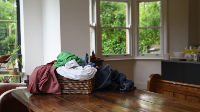 laundry in a basket on a table - wäschekorb stock-videos und b-roll-filmmaterial