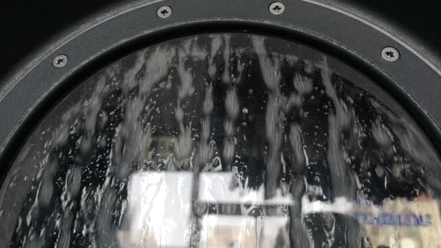 laundry inside a washing machine drum - launderette stock videos & royalty-free footage