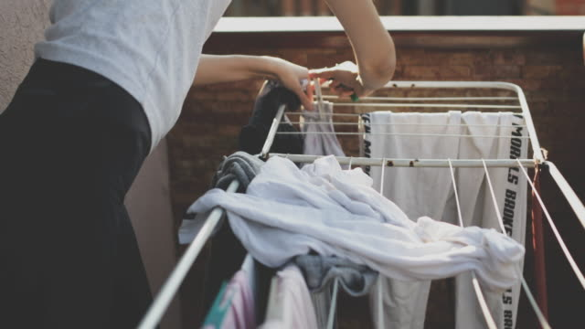 laundry line with clothes - string stock videos & royalty-free footage