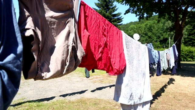 laundry on clothesline - smoked stock videos & royalty-free footage