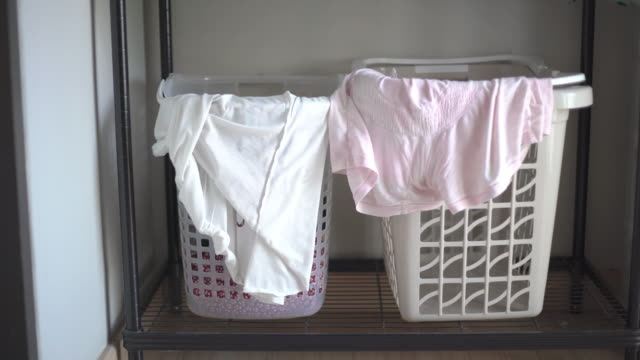 laundry piled in a basket - towel stock videos & royalty-free footage