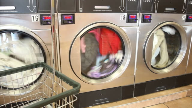 laundry spinning inside washing machines at super suds laundromat in reading pennsylvania on december 12 2011 - launderette stock videos and b-roll footage