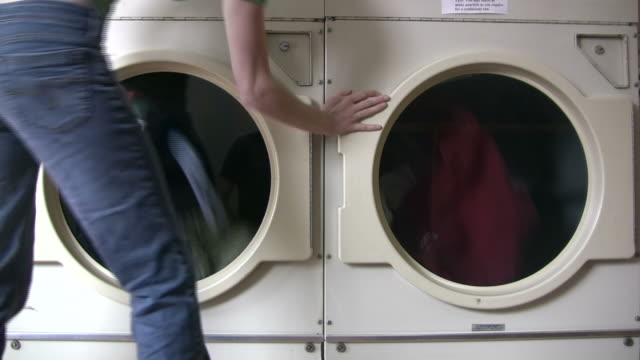 laundry, three clips - launderette stock videos & royalty-free footage