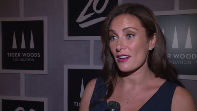 interview – laura benanti on what it means to be celebrating tonight on how the foundation helps beneficiaries at tiger woods foundation event at new... - laura benanti stock videos and b-roll footage