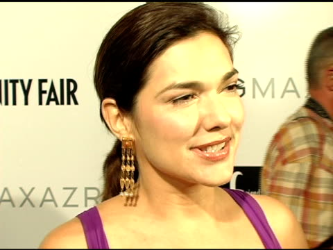 laura harring on what she likes best in dress design and on the projects she just finished including one for hbo at the opening of the new bcbg max... - laura harring stock videos & royalty-free footage