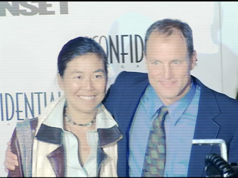 laura louie and woody harrelson at the 'after the sunset' premiere at grauman's chinese theatre in hollywood, california on november 4, 2004. - woody harrelson stock videos & royalty-free footage