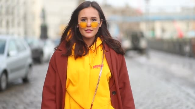 Laura Noltemeyer wearing Dolce Gabbana boots Zimmermann dress yellow broken hoodie Fendi bag Edited coat is seen during the Berlin Fashion Week...