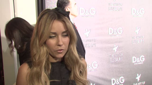 lauren conrad on why she loves dolce & gabbana, on what she's wearing, and on her plans for new years at the d&g flagship boutique opening benefiting... - dolce & gabbana点の映像素材/bロール