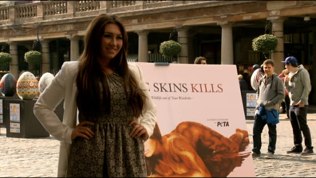 lauren goodger launches peta advert england london covent garden ext lauren goodger posing for photocall next to peta poster depicting her naked and... - body paint stock videos & royalty-free footage